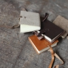 Tiny pocket leather travel journal/notebooks by Nkuku