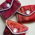 Tiny red brocade ring purse
