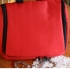 Hanging travel washbag in red by Reisenthel